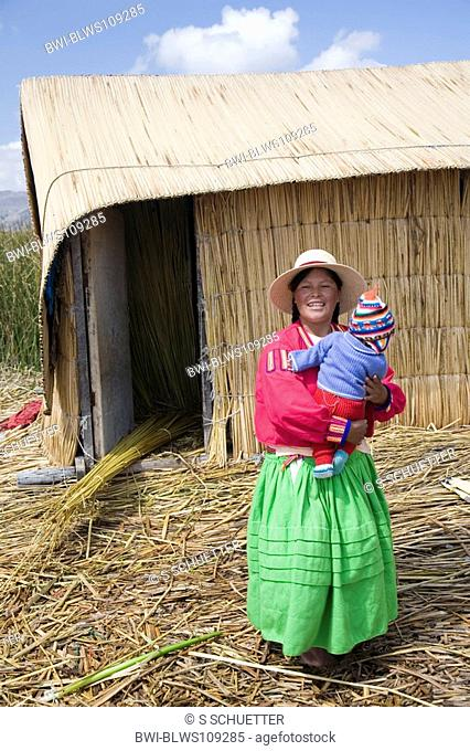 Uro woman with child in front of a reed hut, Peru, Titicaca, Puno