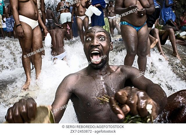 Voodoo Festival in Saut d'Eau, Haiti. A man in trance in one of the pools of Saut d'eau. Voodoo Festival Saut d'Eau is celebrated every year on July 16 to...