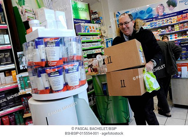 Reportage on a rural pharmacy technician during his home delivery round in Auxi-le-Château, France