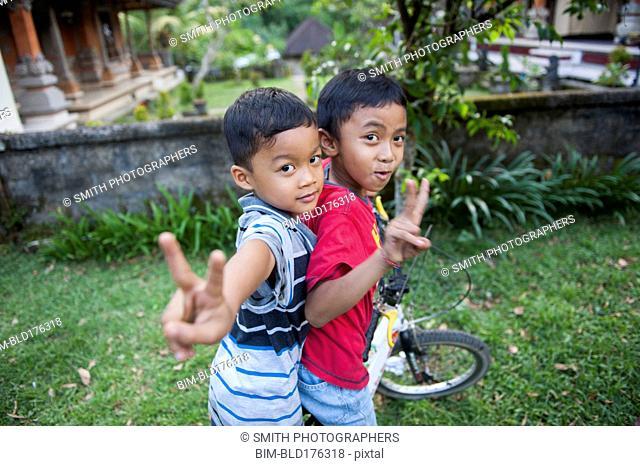 Asian boys playing in backyard