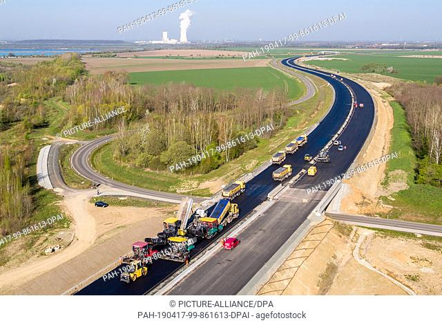 17 April 2019, Saxony, Espenhain: Two asphalt pavers are used to lay the surface course on the new A72 (taken with a drone)