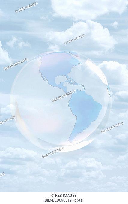 Transparent globe floating in sky