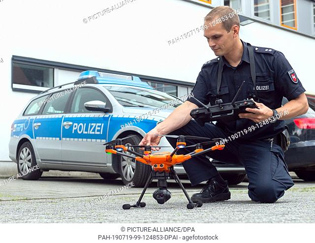 10 July 2019, Lower Saxony, Buchholz: Thomas Müller, drone pilot, checks a drone of the police before the start at a press meeting