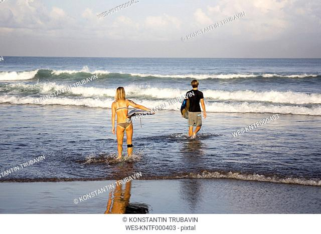 Indonesia, Bali, Surfers on the beach