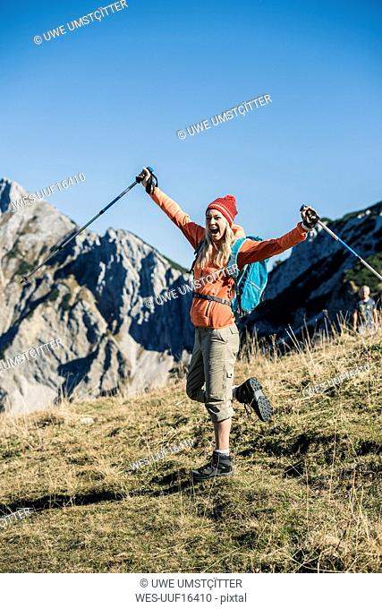 Austria, Tyrol, cheerful woman on a hikig trip in the mountains