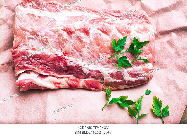 Raw meat and garnish on butcher paper