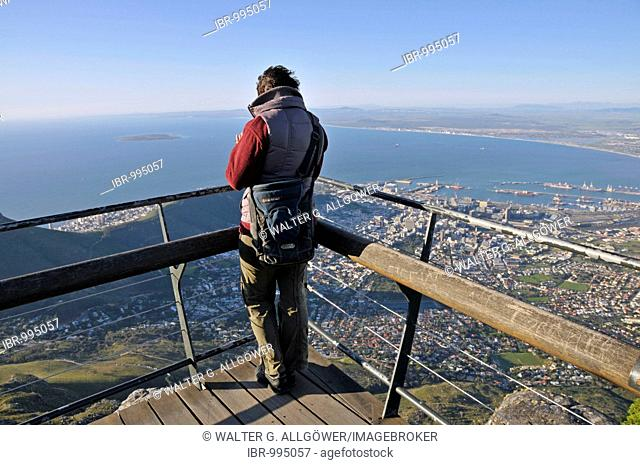 Woman looking onto Cape Town from the top of Table Mountain, South Africa