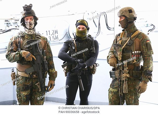 Naval frogmen of the Einsatzflottille 1 (lt. Operation Flotilla) standing on the deck of the Alster corvette at the naval base in Kiel, Germany, 21 April 2017