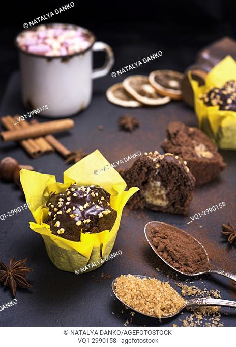 banana chocolate muffins on a black surface, top view