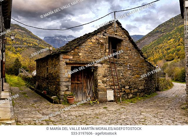 Typical rural house in Broto and Pyrenees on the background. Huesca. Aragon. Spain. Europe