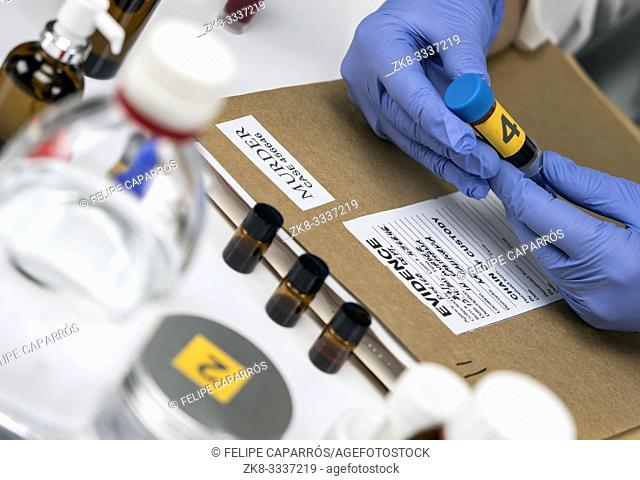 Scientific Police takes blood sample at Laboratory forensic equipment, conceptual image