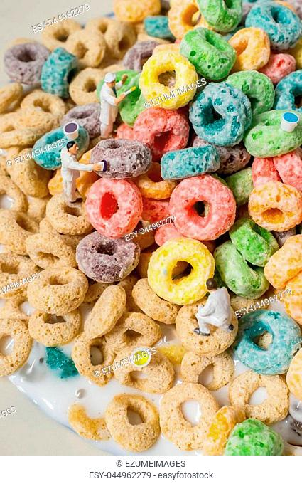 Tiny painting crew paints the oat loop cereal rainbow of colors