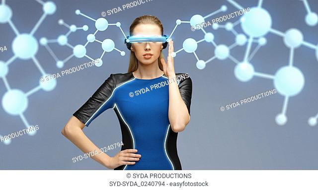woman in virtual reality 3d glasses with molecules