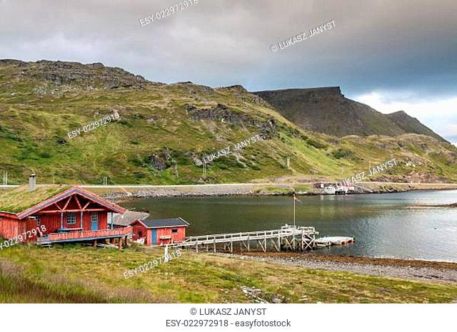 Typical Norwegian fishing village with traditional red rorbu huts,Honningsvåg