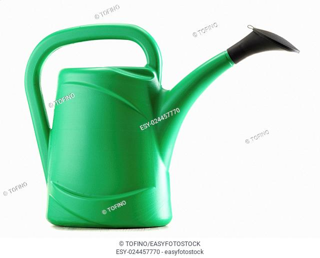 Green plastic watering can isolated on white background