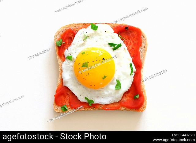 Fried Egg On Slice Of Toast Isolated on White Table