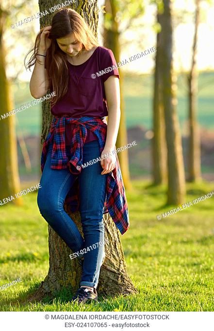 Portrait of a Pretty Teen Girl Standing in a Forest