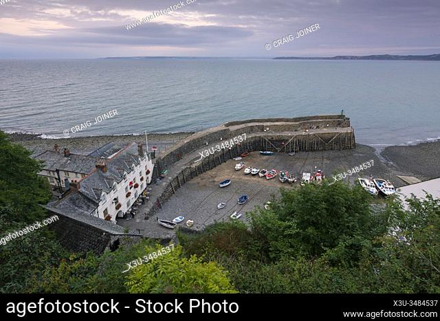 The harbour village of Clovelly on the North Devon coast and Bideford Bay beyond, England