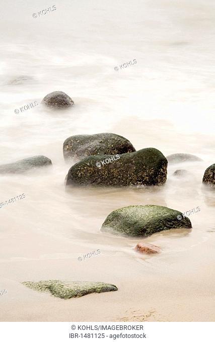 Stones in the surf, Jasmund National Park, Ruegen island, Mecklenburg-Western Pomerania, Germany, Europe