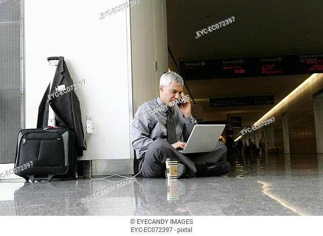 Mature businessman working at airport