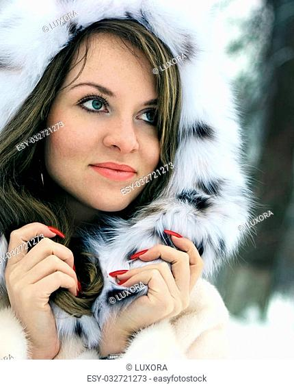 Beautiful lady in fur in the winter