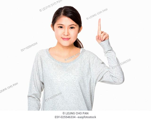 Young girl with finger point up gesture