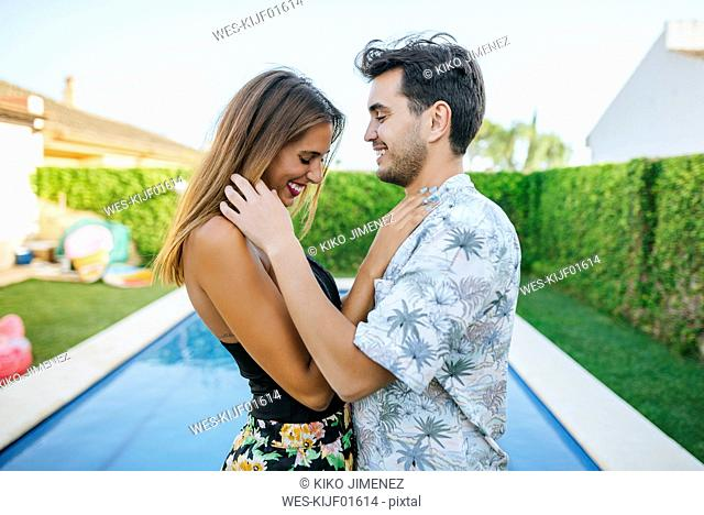 Affectionate happy couple at the poolside