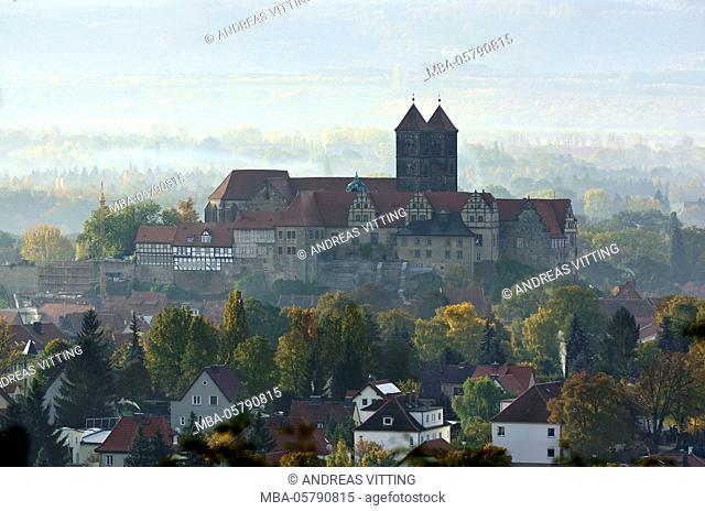 Castle hill with collegiate church St. Servatius in the morning haze, UNESCO world heritage, near Quedlinburg, Saxony-Anhalt, Germany