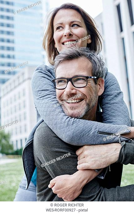 Happy mature couple hugging outdoors