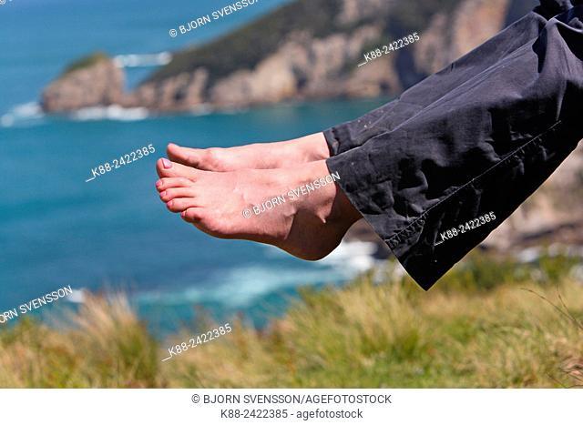 Bushwalker along the Great Ocean Walk resting feet during a break. Victoria, Australia