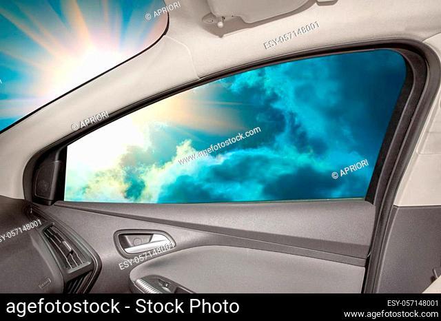 Heavenly landscape behind car window