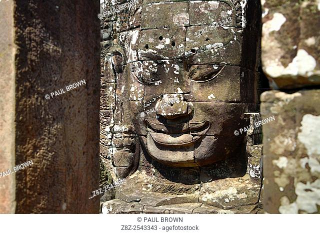 Giant face statue at Bayon, Khmer Temple in Angkor Thom, Siem Reap, Cambodia. Built in the late 12th / early 13th century as the official state temple of the...