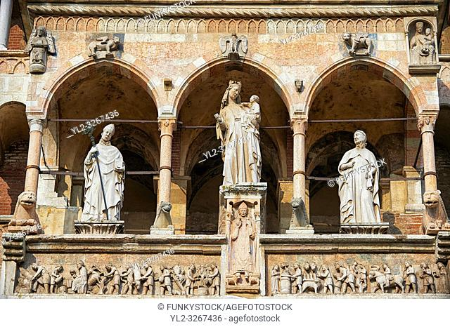 Statue of the Modonna with Child on the facade of the Romanesque Cathedral of Cremona, begun 1107, with later Gothic, Renaissance & Baroque elements, Cremona