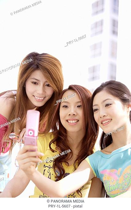 Young women with mobile phone, smiling
