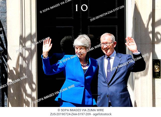 July 24, 2019, London, United Kingdom: British Prime Minister Theresa May (L) and her husband Philip May (R) wave on the steps of 10 Downing Street after her...