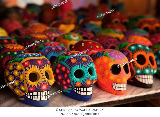Colorful skulls in the souvenir shop at Tulum town, Tulum, Quintana Roo, Yucatan Province, Mexico, Central America