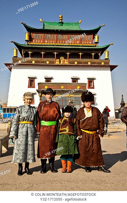 Family in traditional clothing pose for portrait, Ganden Buddhist monastery, Ulan Baatar, Mongolia