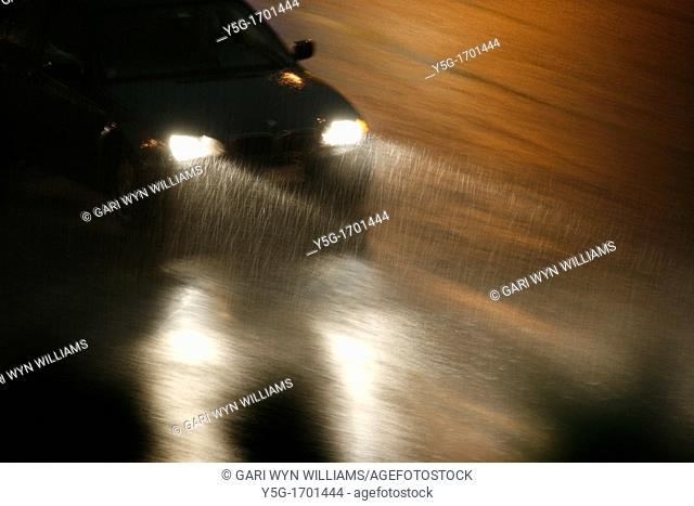 fast car driving in heavy rain at night in town