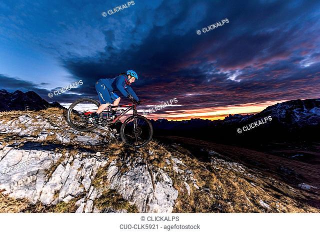 Mountain bikers at sunriseSan Pellegrino, Moena, Fassa Valley, Dolomites, Trentino, Italy, Europe