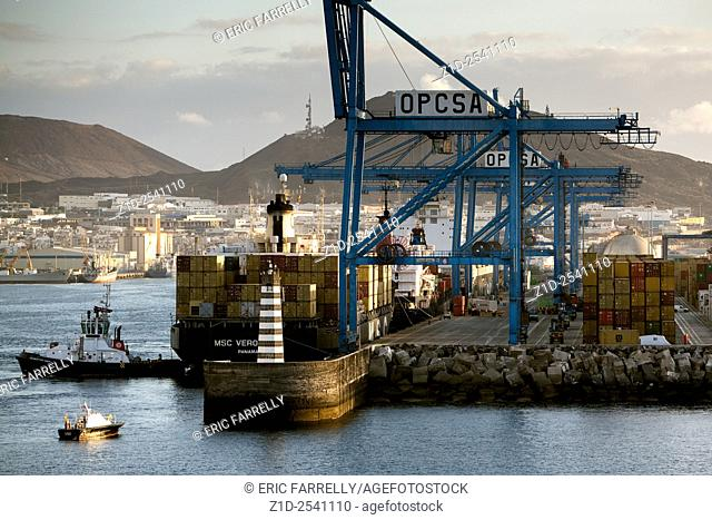 "The """"Msc Veronique"""" just arriving at the Canary Islands as the tugs gently nose her into her berth"
