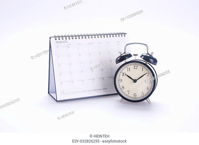 alarm clock with calendar. alarm clock with calendar on background