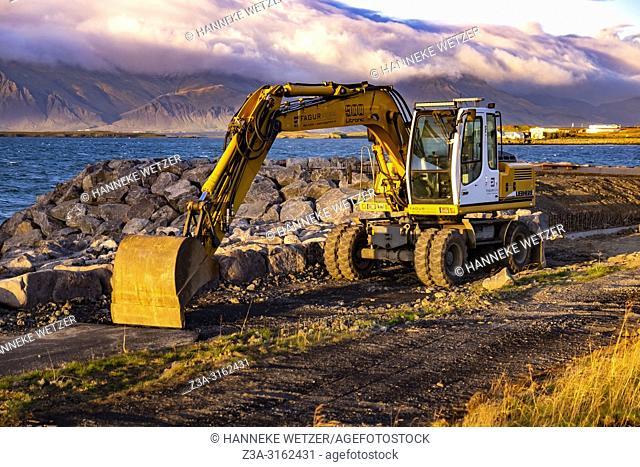 Excavator at a construction site at the coastline of Reykjavik, Iceland