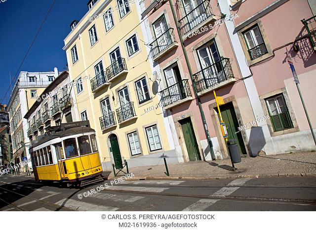 Tram in a street in Alfama district, Lisbon, Portugal, Europe