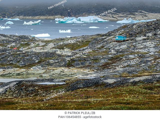 23.06.2018, Gronland, Denmark: A single house stands in the barren landscape near the coastal town of Ilulissat in western Greenland