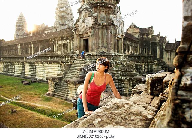Woman visiting ancient temple, Angkor, Siem Reap, Cambodia