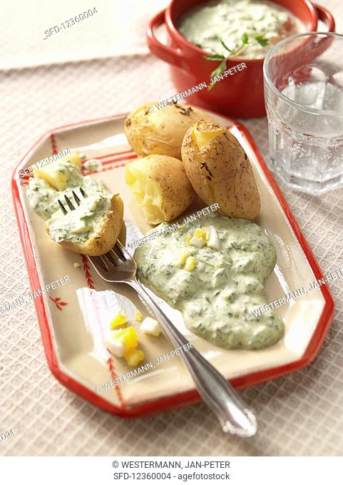 Egg and potatoes with green sauce