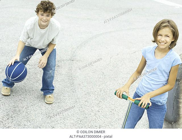 Suburban children playing in street