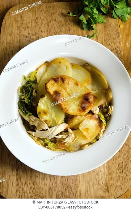 Chicken and vegetable hotpot with gravy on a plate
