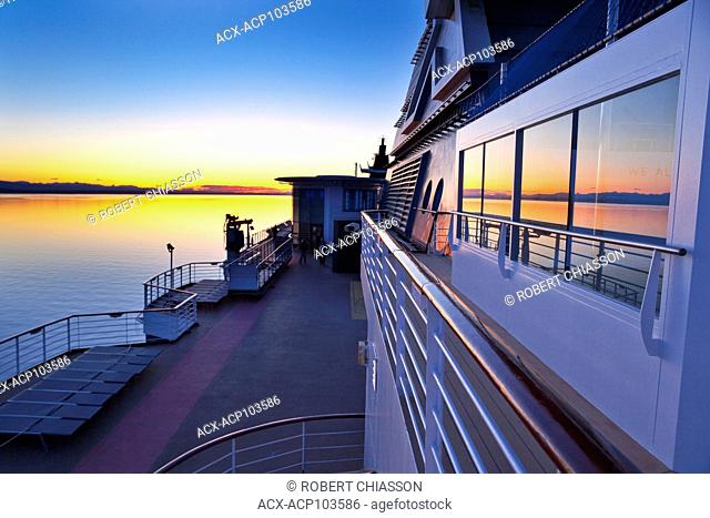 Sunset over the Inside Passage as seen from the upper deck of a cruise ship, British Columbia, Canada