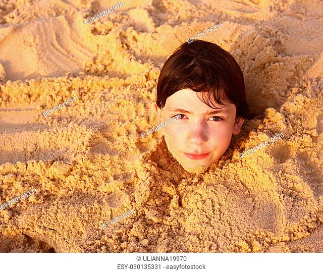 preteen handsome boy in the sand cave on the thai beach happy close up portrait
